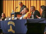 From left, Eric Kiser, Tom Johnson, Cindy Perry, moderator Jerry Anderson, Brad McDonald, David Hunter, Mark Hughes, and Lisa Canales participate during a Washington Local School board of education candidate forum at Whitmer High School.