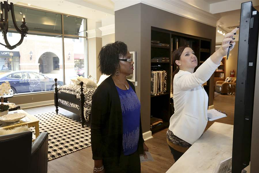Deborah Washington  left  talks with design consultant Jamie Mueller as Ms   Washington shops at the new Ethan Allen furniture store at Levis Commons in. Ethan Allen soars in Perrysburg   The Blade