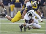 Michigan defensive end Chris Wormley (43) sacks Michigan State quarterback Connor Cook earlier this year. Wormley, a Toledo product, will try to beat Ohio State for the first time Saturday.