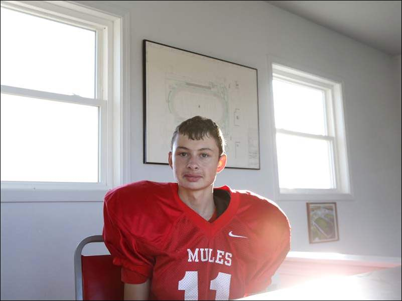 Bedford's Nick Hugo, 16, who has Asperger's Syndrome, has been the freshman football team's manager for two years.