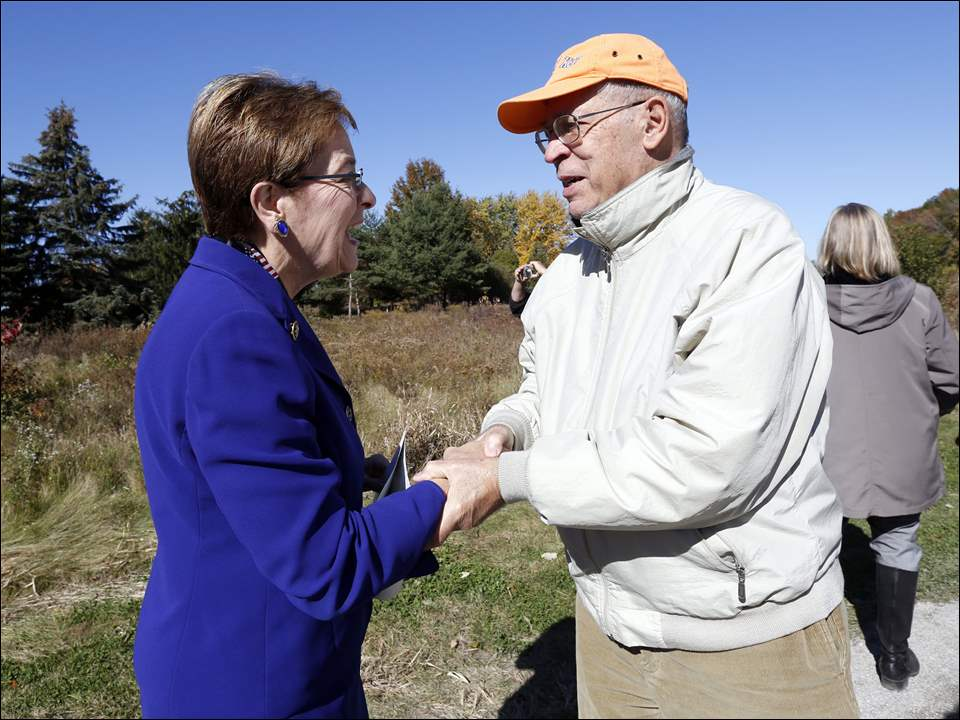 Keynote speaker U.S. Rep. Marcy Kaptur (D., Toledo), left, shakes hands with Steve Shawaker of Sylvania Township during the dedication of the Fallen Timbers Battlefield, located at U.S. 24 and Jerome Road, in Maumee on Sunday.