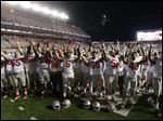 Ohio State players sing the alma mater on the field after an NCAA college football game against Rutgers on Saturday.