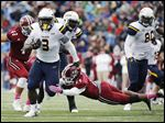 UT's Kareem Hunt, who had 90 yards on 20 carries, gets past Massachusetts defensive back Charan Singh.