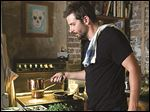 This photo provided by The Weinstein Company shows Bradley Cooper as Adam Jones in a scene from the film,