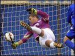 Anthony Wayne goalkeeper Brendan Vaughn tries to block a shot against St. Francis in the Division I district final.