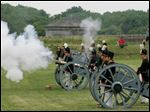 A cannon is fired by re-enactors from the Old Northwest Military History Association during a reenactment of the July 4, 1813 Independence Day celebration, at Fort Meigs in Perrysburg, Ohio, Saturday, July 4, 2009.   Summary: July 4 celebration at Fort Meigs in Perrysburg.
