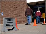 Voters head into Southview High School in Sylvania to cast their ballot.