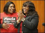 Mayor Paula Hicks-Hudson, right, and her daughter Leah Hudson, left, applaud the results on Election Day.