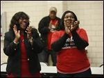 Mayor Paula Hicks-Hudson, left, and her daughter Leah Hudson, right, applaud the results which show Hicks-Hudson well ahead in the polls while watching the results at UAW Local 12 on election night.