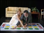 Rochester residents Lauren Sodano and Shawn Gray portray Eva Gabor and Johnny Carson, playing Twister at the National Toy Hall of Fame announcement Thursday in Rochester, N.Y.