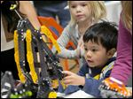 Kenzie Nakamoto, 4, plays with Hexbug toys at online toy review site TTPM's Holiday Showcase in New York.