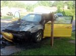 This May 2014 photo provided by Elizabeth Berry shows her fire-damaged 2003 Chevrolet Monte Carlo SS. Five years earlier, Berry had answered a recall notice from General Motors for a repair that was supposed to prevent engine fires. However, during the fall of 2015, Berry learned that she is one of 1,345 car owners in towns across the U.S. whose cars caught fire even after getting the repair called for in the recall.