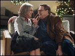 Diane Keaton, left, as Charlotte, and John Goodman as Sam, in 'Love the Coopers.'