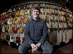 Brian Douglas owns the Cream City Music store in Brookfield, Wis.