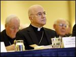 Archbishop Carlo Maria Vigano, Apostolic Nuncio to United States, listens to remarks at the United States Conference of Catholic Bishops' annual fall meeting, today in Baltimore.