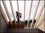 A worker installs a roof on a zero net energy home in New Paltz, N.Y. The National Association of Home Builders reports a dip in homebuilder confidence in November.