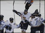 Toledo Walleye A.J. Jenks, center, has been named the ECHL's Player of the Week.