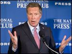 Republican presidential candidate, Ohio Gov. John Kasich speaks at the National Press Club in Washington Nov. 17.