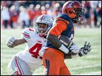 Darron Lee, left, is just one of many on the Buckeyes defensive line viewed as NFL-draft ready.