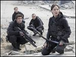 From left, Liam Hemsworth as Gale Hawthorne, Sam Claflin as Finnick Odair,  Evan Ross as Messalla, and Jennifer Lawrence as Katniss Everdeen in a scene from 'The Hunger Games: Mockingjay — Part 2.'