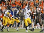University of Toledo DE Trent Voss (43) recovers a fumble against Bowling Green State University during a MAC football game Tuesday.