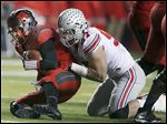 Ohio State's Joey Bosa sacks Rutgers quarterback Chris Laviano. Bosa is one of a possible dozen Buckeye nonseniors who might enter the NFL draft.