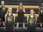 Perrysburg is picked to win the Northern Lakes League title with top players, front, from left, Macy Tudor and Erika Joldrichsen, and back, from left, Ashlynn Brown, Taylin Hunter, and Katie Diehl.