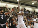Bowling Green's Wes Alcegaire shoots over Cincinnati's Gary Clark in Wednesday night's game at Stroh Center.