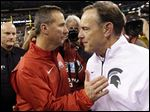 Ohio State's Urban Meyer, left, will square off with Michigan State's Mark Dantonio on Saturday.