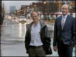 United North CEO Terry Glazer, left, and his replacement, Steve Seaton, stand along Lagrange Street in Toledo. Mr. Seaton lauded Mr. Glazer's work and his leadership.