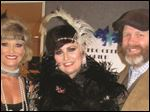 Traci Schwann, event chairman, Tiffany Noel Taylor, and Richard Furlong, play the part at the Toledo Opera Guild event.