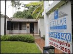 A home is for sale in Coral Gables, Fla. Fewer Americans bought homes in October, a sign that rising home values may be pushing more would-be buyers to the real estate market's sidelines, based on information released today.