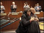 Paula Hicks-Hudson hugs Judge Arlene Singer after being sworn in as mayor of Toledo in City Council Chambers.