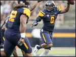Toledo safety Chaz Whittaker celebrates his interception against Stony Brook on Sept. 3. The Rockets host Western Michigan on Friday.