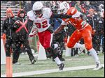 Ball State's Jahwan Edwards is chased by BG's Gabe Martin during last year's game, which featured snow and temperatures in the 20s.