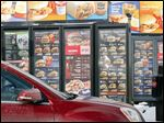 A customer looks at the menu at McDonald's drive-thru in Williamsville, N.Y. The company is changing its processes to improve accuracy in filling drive-thru orders.