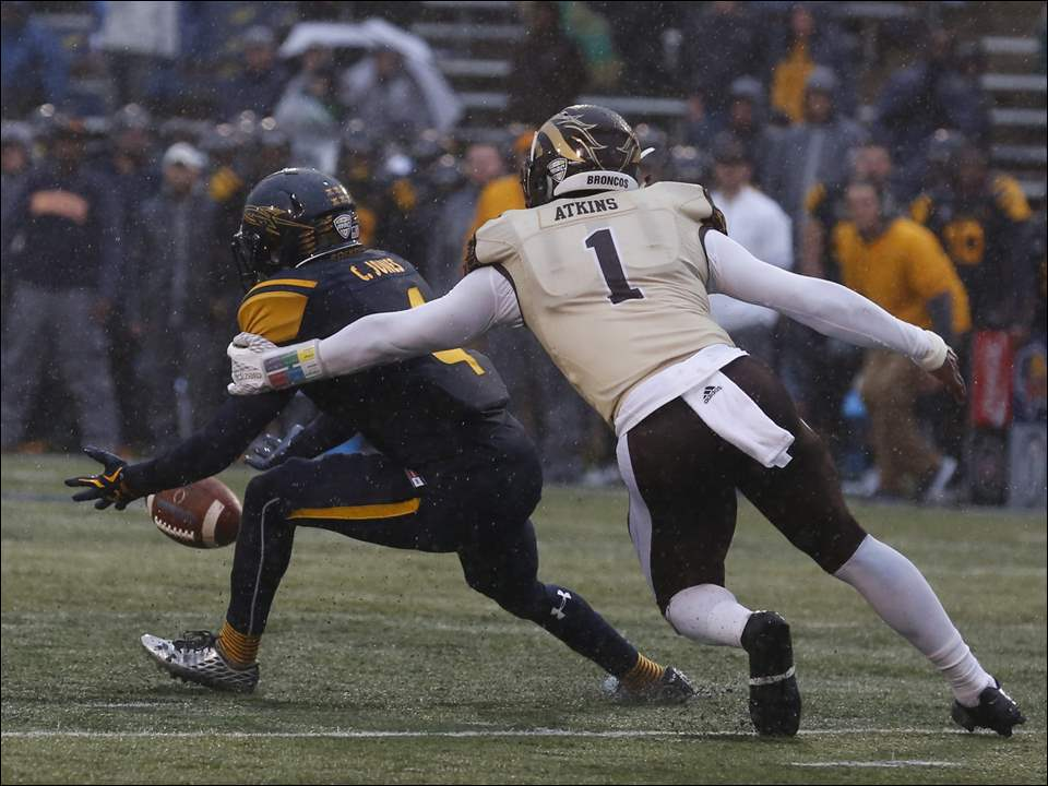 Toledo's Corey Jones drops a pass under pressure from WMU's Rontavious Atkins during second half of UT's 35-30 loss to Western Michigan at the Glass Bowl on Friday.