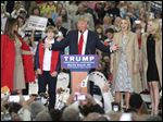 Republican presidential candidate Donald Trump, middle, speaks near his wife, Melania, left, son Baron, daughter Ivanka, second from right, and daughter Tiffany during a campaign event at the Myrtle Beach Convention Center.