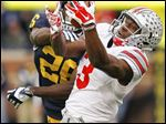 Ohio State wide receiver Michael Thomas makes a catch for long yardage against  Michigan cornerback Jourdan Lewis in the fourth quarter of Saturday's game in Ann Arbor.