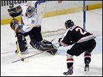 Walleye goalie Jeff Lerg, left, who finished with 24 saves on Friday, defends against Brampton's Zach McCullough.