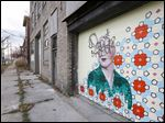 An UpTown Toledo mural on the side of the building at 1301 Adams St. has been vandalized.