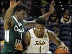 Toledo's Jonathan Williams, who had 17 points, drives against Cleveland State's Andre Yates in Wednsday night's game in Savage Arena. It was the first game home for the Rockets after a recent trip to Alaska. UT improved to 5-2.