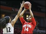 Ohio State's Ameryst Alston tries to shoot over Cincinnati's Alyesha Lovett in the first half of the Buckeyes' victory. Alston had 16 points and nine assists for the 10th-ranked Buckeyes.
