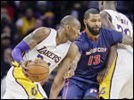 Los Angeles Lakers forward Kobe Bryant tries to drive around Detroit forward Marcus Morris in the first half.
