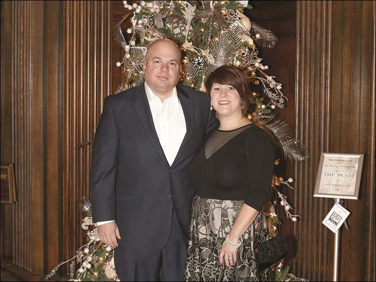 Dazzling holiday trees have been added to the stately Toledo Club's holiday decor as part of the club's annual Parade of Trees. Chris and Wendy Baker of Sylvania attended the dinner Dec. 8.