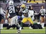 Green Bay Packers wide receiver James Jones (89) catches a touchdown pass next to Oakland Raiders free safety Charles Woodson (24) during the second half Sunday.