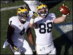 Tight end Jake Butt, right, celebrating a touchdown with De'Veon Smith in November, sought advice from Wolverines coach Jim Harbaugh, among others, on his decision to play one more year for Michigan.