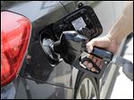 Gas prices continue to fall, reaching an average of $1.82 per gallon.