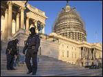 U.S. Capitol Police officers endure sub-freezing temperatures as lawmakers return to work after the holiday break, Tuesday,.