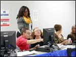 LaVera Scott,supervises poll workers on the first day of early voting at the  Lucas County Early Vote Center in October, 2014.